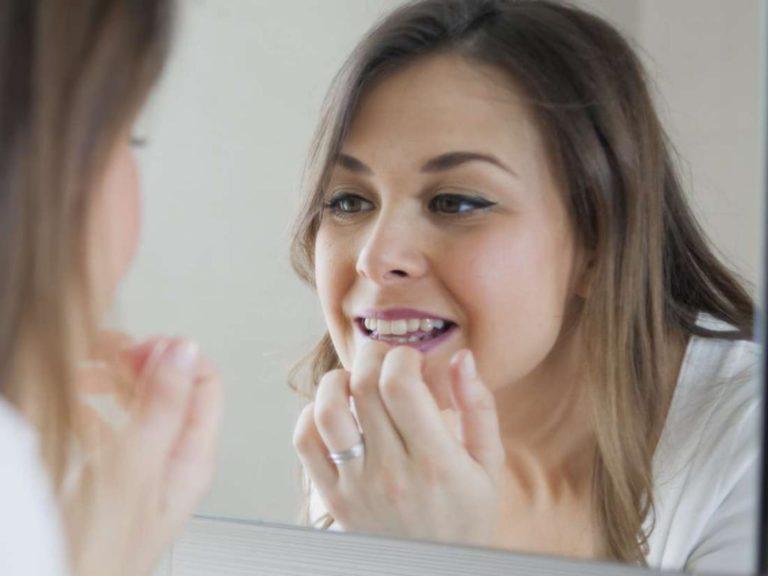 Как привыкнуть к съемному зубному протезу